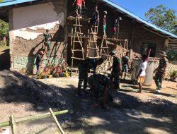 Bersama Warga, Personel Pos Lakmars Gotong Royong Rehab Gereja Arnoldus Yansen